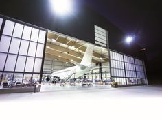 Butzbach is a leading manufacturer of hangar doors for hangars and airports ► Learn now more about our products & custom-made products! Sliding Doors, Garage Doors, Photo Archive, Design Projects, Architecture, Building, Image, Panel, Hangers