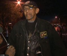 """Robert Valentine (right) identified himself as 'just a solider' during an interview he did with CNN in Baltimore: """"I'm not black, white, red, yellow, or nothing. I'm an American."""""""