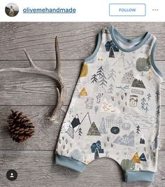 Organic and natural brand children's wear romper flat lay