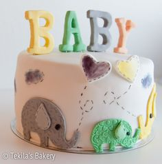 Baby shower cake with elephant family and hearts
