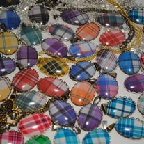 "One custom tartan necklace set in an 18x25 metal lace setting on an 18-24"" adjustable chain.    Comes with the option of one of three metal finishes: antique bronze, silver, or gold. (Gold currently comes with a non-adjustable 18"" ball chain. Contact me for other options, including custom chains/lengths.)    Please include the tartan you'd like..."