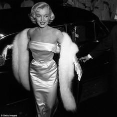 Looking every inch the Hollywood legend she is remembered as today, Marilyn arrives at the premiere of the 1954 Walter Lang film There's No Business like Show Business