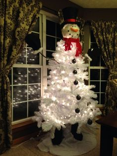 Snowman Decorated Christmas Tree Snowman Christmas Tree. Snowman Tree Topper From Cracker Barrel