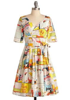 The print is sewing-themed comic strips.  It looks like something Ms. Frizzle, of Magic School Bus fame, would wear the day she teaches about  garment construction!
