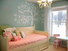 only a few throw pillows acknowledge the color of the wall which makes it cohesive but not matchy matchy