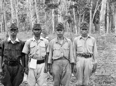 SANDAKAN, NORTH BORNEO 1945-10-26. SUSPECTED JAPANESE WAR CRIMINALS. LEFT TO RIGHT: CAPTAIN NAKATA SHINICHI; WARRANT OFFICER KOSAKA SHIGEO; SERGEANT MAJOR EHARA KESAO; AND SERGEANT MAJOR MATSUI SHINTARO. Four of the Japanese camp staff at Sandakan responsible for the conditions which resulted in the deaths of all of the remaining Australian and British prisoners of war. These men were tried as war criminals: three were convicted of brutality or murder and were imprisoned or executed.
