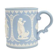 Powder blue mug with classical figures.