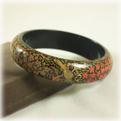 Brightly hand painted vintage Nordstrom wood bangle. A lovely design with a mixture of flowers, leaves, and birds. Colors are in excellent