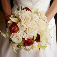 Stephanotis, mini lily and hydrangea ivory bridal bouquet with hints of red roses