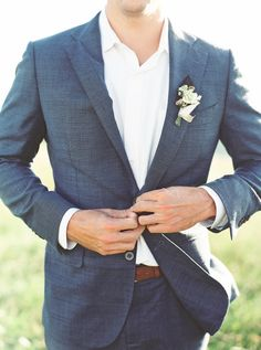 Unique slate blue stitched suit: http://www.stylemepretty.com/little-black-book-blog/2016/09/30/breathtaking-mountain-elopement-north-carolina/ Photography: Simply Sarah - http://simplysarah.me/
