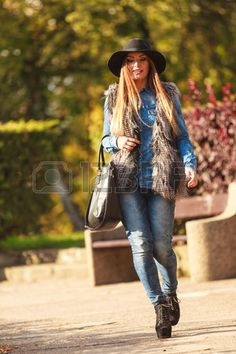 Autumnal fashion of women. Attractive young stylish model posing outdoors…