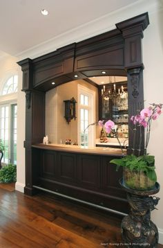 bar between kitchen and living room---love the bold architectural facade