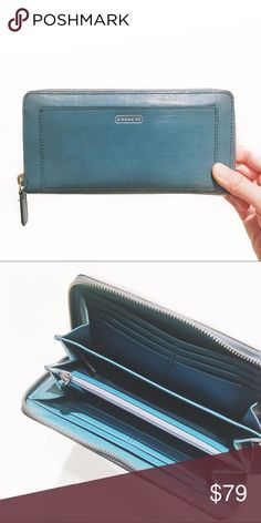 Coach Turquoise Leather Wallet I just got another wallet so I ended up only using this one for a week. Tons of pockets to organize your credit cards, stamp cards, or whatever else you have in your wallet. Also love that it has a zip compartment for coins. No damage or staining, in mint condition! Bags Wallets