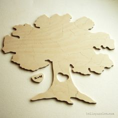 Tree shaped wood wedding guest book puzzle. Bella Puzzles.