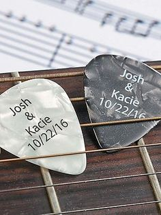 Personalized guitar picks for wedding favors.