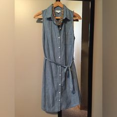 Old Navy denim chambray button-down dress NWOT This dress has never been worn. It's sleeveless and quite adorable. It could be layered for those cooler days too. Dress it up or down. Old Navy Dresses Midi