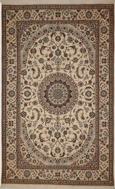 Very, very fine Persian Nain woven with silk inlay, ivory color field with beige borders and a round center medallion Circa 1990
