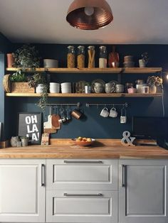 Laura has used Hague Blue on her Kitchen walls as a backdrop to her rustic shelves. The combination of wood, plants, copper and greys against the blue works beautifully here decor colour Dark blue walls. Kitchen Wall Colors, Home Decor Kitchen, Kitchen Interior, New Kitchen, Home Kitchens, Decorating Kitchen, Blue Walls Kitchen, Plants In Kitchen, Copper And Grey Kitchen