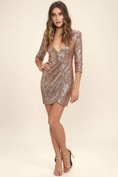 The Sequin-ing Hearts Rose Gold Sequin Dress appeals to lovers of all things sparkly! Dazzling sequins adorn this woven poly number with three-quarter sleeves, a princess-seamed bodice, an a plunging, V-neckline. Fitted, wrap skirt gathers at the hip before draping into a rounded front hem for a flirty finale. Hidden back zipper/clasp.