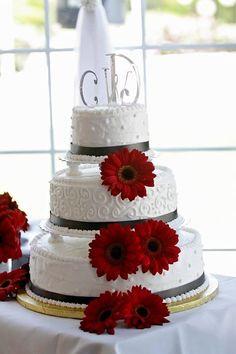 White wedding cake with red Gerbera Daisies wedding cake!