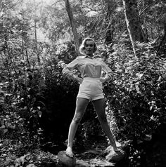 "A barefoot Monroe balances on rocks over a tiny brook. In a 1999 interview with Digital Journalist, photographer Ed Clark described how in 1950 he received a call from a friend at 20th Century Fox about ""a hot tomato"" the studio had just signed: Marilyn."