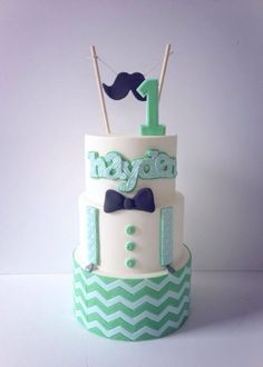 Little Man Cake - Blue velvet inside, lime green chevron over white fondant on bottom, blue ribbon at seam, green fondant suspender/buttons and blue bow tie