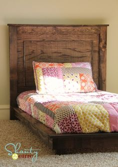 How to build a platform bed for $30. Inspired by Pottery Barn Kids Fillmore Platform Bed. That would make an amazing bed for Evelyn when she gets her own room, and I can make bedding just like that if I wanted to. :)