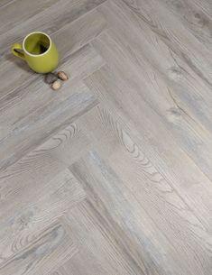 A parquet herringbone laminate with rating. Wood Floors in stock. Herringbone Laminate Flooring, Grey Vinyl Flooring, Herringbone Wood Floor, Grey Wood Floors, Solid Wood Flooring, Engineered Wood Floors, Parquet Flooring, Kitchen Flooring, White Floorboards