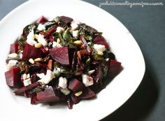 Warm Beet Green Salad with Beets, Goat Cheese, and PineNuts