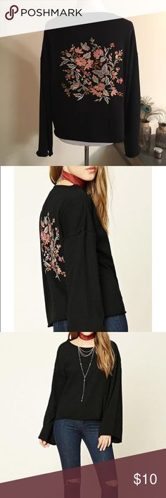 Black Raw Cut Embroidered Sweatshirt New with tag. Gorgeous embroidery on back of Sweatshirt. Floral and butterflies! Raw cut bottom and bell sleeves. Size Medium. Runs oversized. 63% polyester 37% cotton. I love the contrast on the black. Can be worn oversized and off the shoulder. Accidental babe Forever 21 Tops Sweatshirts & Hoodies