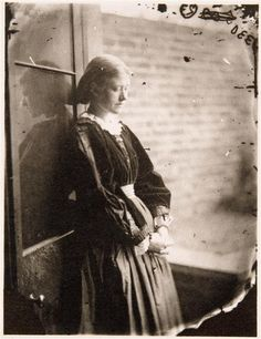A young woman takes a moment to rest - perhaps gathering her thoughts in the process - in the sunlight that shone down on the world in 1865. #1800s #Victorian #woman #19th_century #sunlight