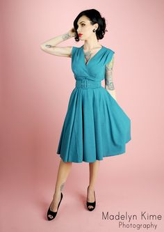 I think the tattoos look awful, but the color on this dress is amazing and it's so elegant.