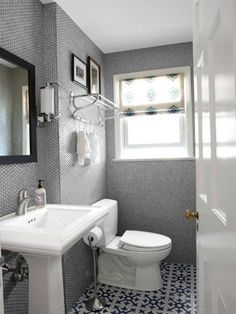 07 grey and white bathroom silver bathroom silver penny tiles pedestal sink blue and white pattern tile floor modern bathroom countryliving Gray And White Bathroom, Silver Bathroom, Grey Bathrooms, Beautiful Bathrooms, Modern Bathroom, Bathroom Interior, Bathroom Small, Design Bathroom, Bathroom Layout