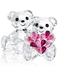 A precious pair! Beautifully crafted in clear crystal, these Kris bears make the perfect gift for a loved one. Featuring a lustrous heart in gradations of pink crystal, it's an eye-catching accent for