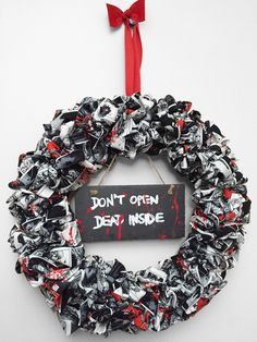 Walking Dead Wreath by CosmicZombies on Etsy https://www.etsy.com/listing/225507838/walking-dead-wreath
