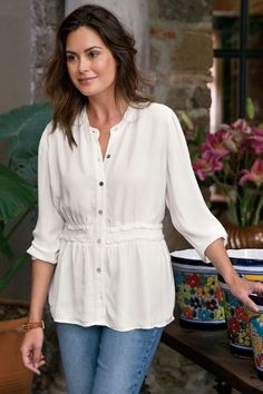 Pretty details highlight this softly textured viscose crepe shirt, especially the set-in waistband with petite ruffles and ruching for a flattering style, finished with a band