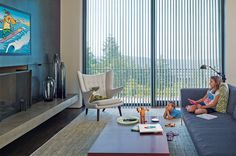 Dim Light or Dim Sum.  With Luminette® Privacy Sheers open vanes to invite the light and close vanes to dim light when needed to make a room perfect for watching tv. #hunterdouglas #windowtreatments #livingroom #bluedecor