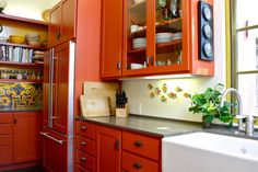 I'm not painting my cabinets anytime soon...but this has MANY pics of Kitchens with Color!