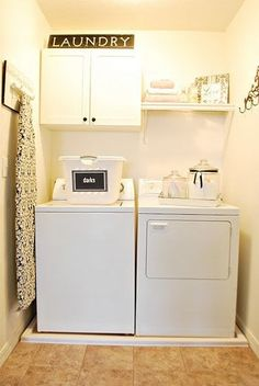 hanging ironing board! Simple, clean, small laundry room.