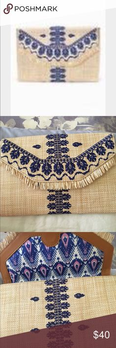"""Stella & Dot CITY SLIM CLUTCH EMBROIDERED INDIGO Brand new never used. Grab this envelope clutch to complement a casual or dress outfit. Toss in your cash, cards and lip gloss and you're ready for a chic night out.  Measurements: 7"""" Height x 10 3/4"""" Length Exterior: Coated raffia. Interior: Vegan leather trims, holds up to 6 credit cards, fits an iPhone or iPad mini. Lining: Perfectly wipeable material in pink and blue ikat print. Hardware: 9K shiny gold plating Stella & Dot Bags Clutches…"""