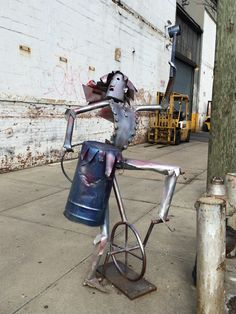 Metal figure riding a unicycle in Red Hook on Van Brunt and Bowne.