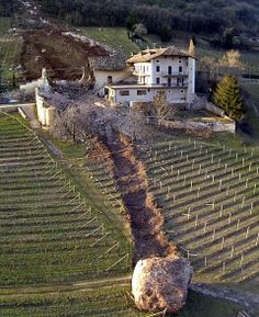 Near miss! I shall never anger the giants again! By the way this is a real photo from Italy - the boulder came from a landslide on January 23, 2014.
