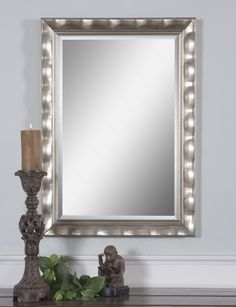 Scalloped frame finished in lightly antiqued silver leaf. Mirror is beveled. May be hung horizontal or vertical. Packed 2 per box but priced individually. Designer: Grace Feyock Dimensions: 24 W X 34 H X 1 D (in)