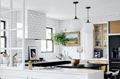 A designer's kitchen goes from pink and pretty to chic and contemporary