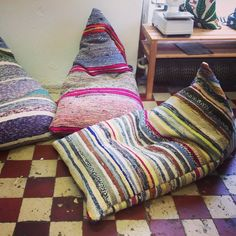 Made with woven rugs sewn together?