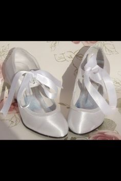 Ivory ribbon vintage style shoes, bhs & debenhams a good start point. A good tip ive found at my expense they are a size generous, always buy 1 size smaller than your shoe size!
