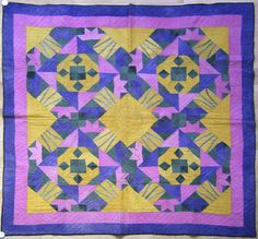 North Carolina Amish pieced quilt, ca. 1900, in a abstract lily pattern in purple, pink, green, and yellow.