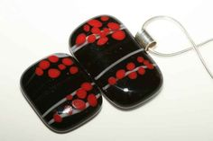 fused glass, pendant. black cabochon - 2 layer, white stringer, red frit. * would be interesting with reactive turq and fr. vanilla