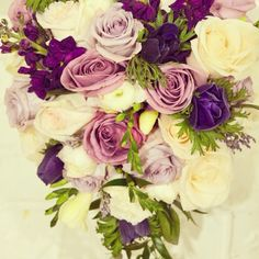fabulous vancouver wedding This has to be one of my favourite bouquets of 2015. Cascading bouquet featuring mauve garden roses, white ranunculus, deep purple anemones for E+K's winter wedding. What's your dream bouquet this year? #weddingbouquet #purpleflowers #vancouverweddingvendor #vancouverweddingflorist #postmarkflowers #purplebouquet #winterwedding #vancouverbride by @postmarkflowers  #vancouverflorist #vancouverwedding #vancouverwedding