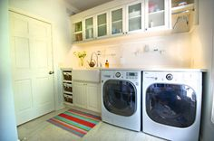 Laundry Room - would like to have a counter on top of the machines for folding/ironing, most probably a wood baseboard with hinges that can be folded away when not in use.
